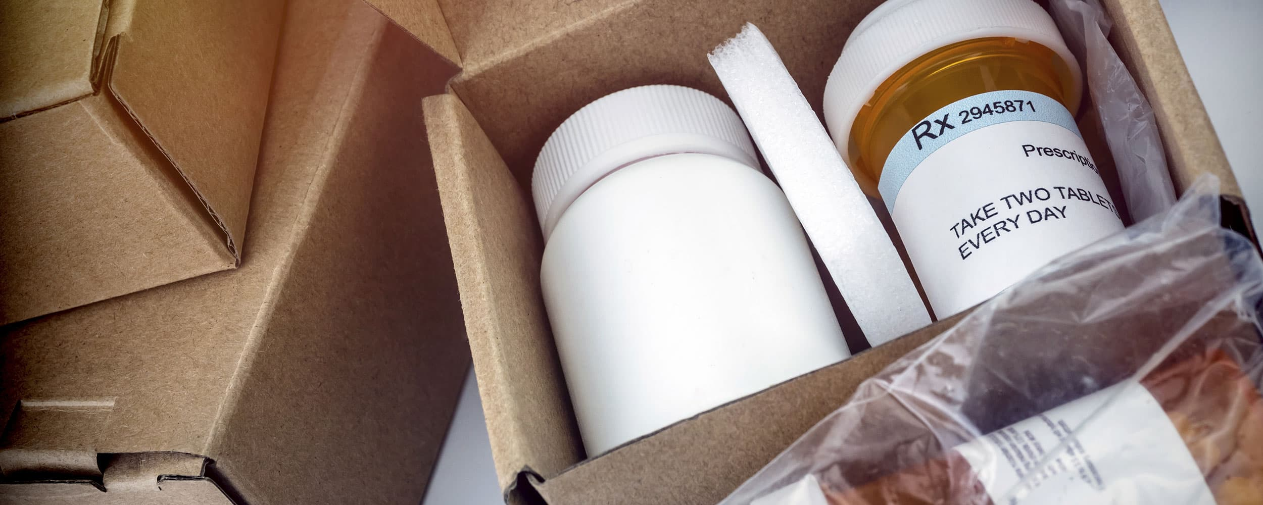 Boxes filled with prescription medicine bottles