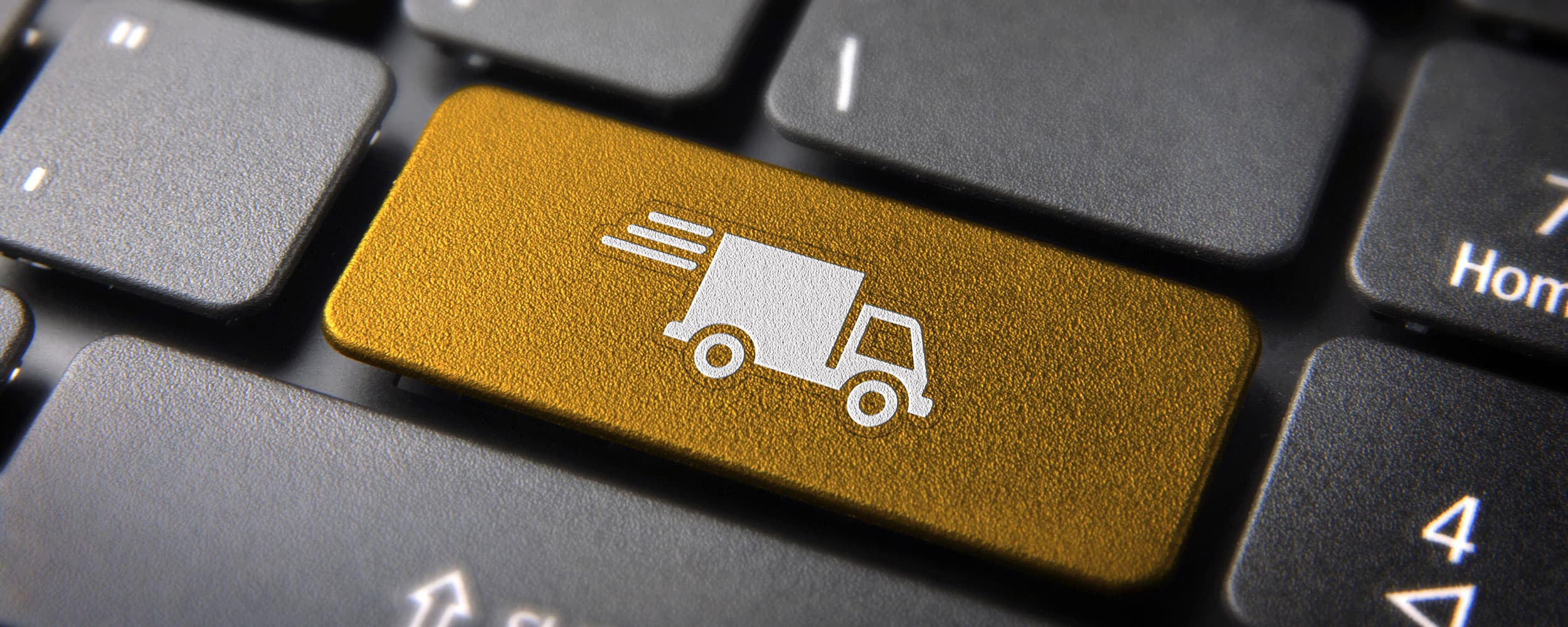 Computer key with painted gold with white delivery truck in the center